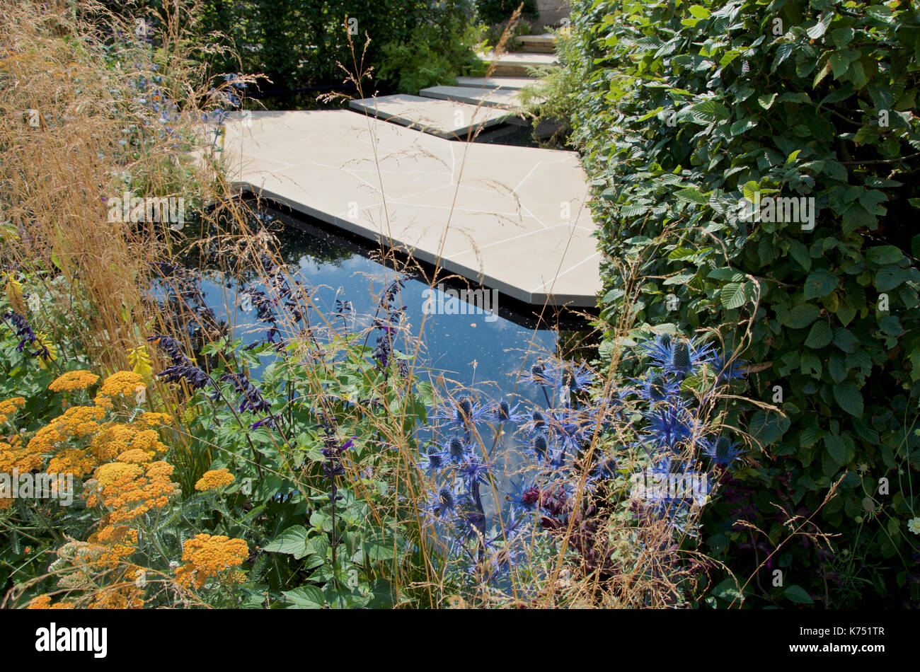 Modern paving based on 'crazy paving' technique in the Watch This Space garden designed by Andy Sturgeon at RHS Hampton Court Palace Flower Show 2017. - Stock Image
