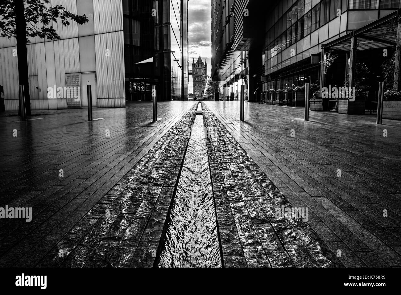 Black white pic of tower bridge from london streets stock image