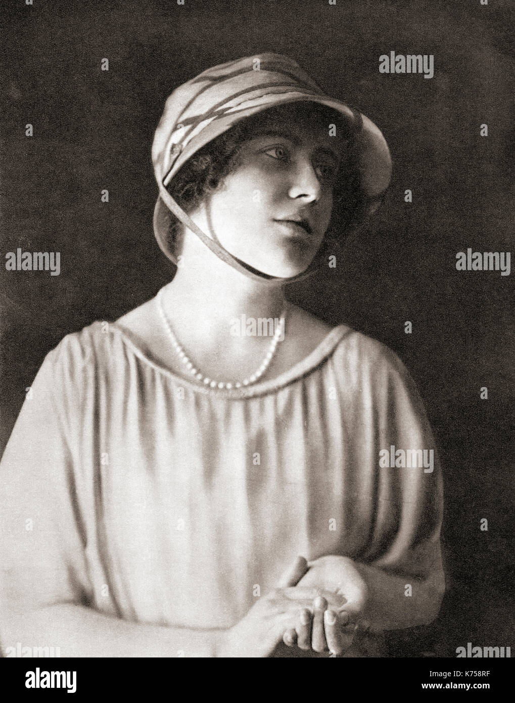 Lady  Elizabeth Angela Marguerite Bowes-Lyon, 1900 – 2002, seen here aged 21.  Future Duchess of York, Queen Elizabeth as wife of King George VI and mother of Queen Elizabeth II.  From The Coronation Book of King George VI and Queen Elizabeth, published 1937. - Stock Image
