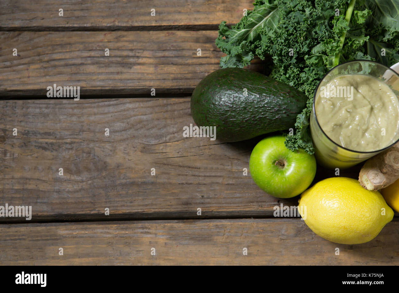 Overhead of various ingredients and paste on wooden table - Stock Image