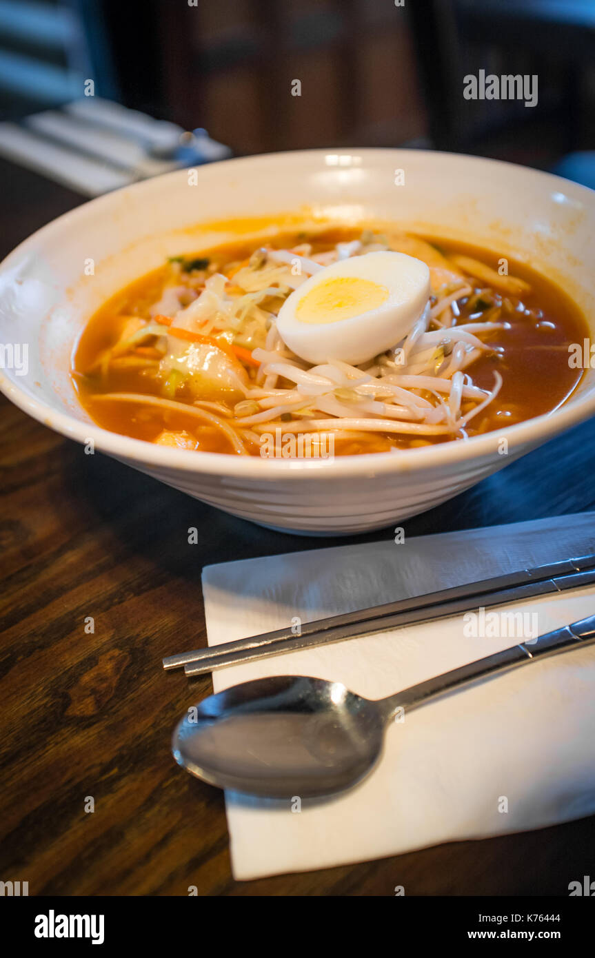 Spicy Korean ramen with mung bean sprouts and hard boiled egg - Stock Image