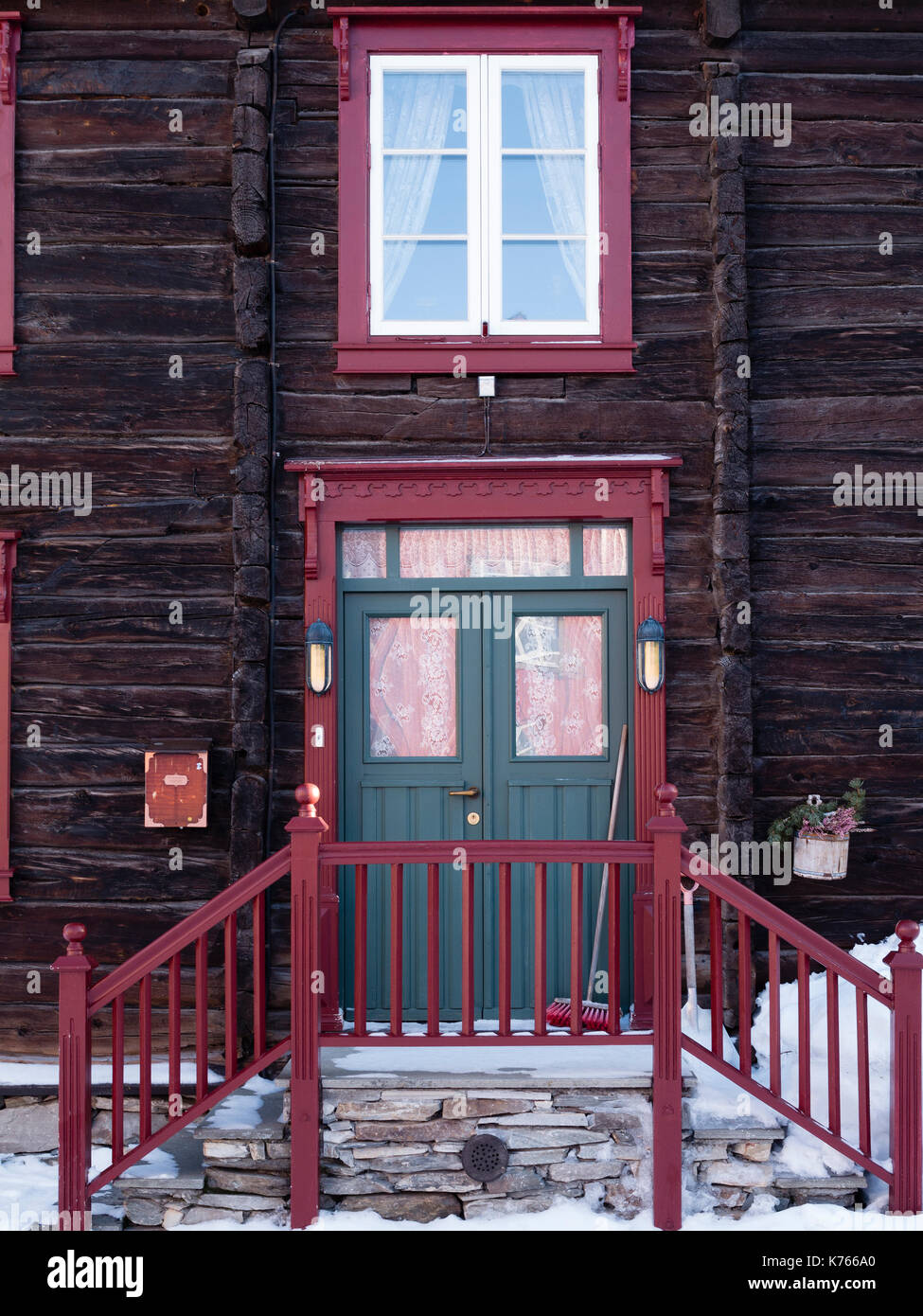 Old wooden house with double door in Röros, Norway. - Stock Image