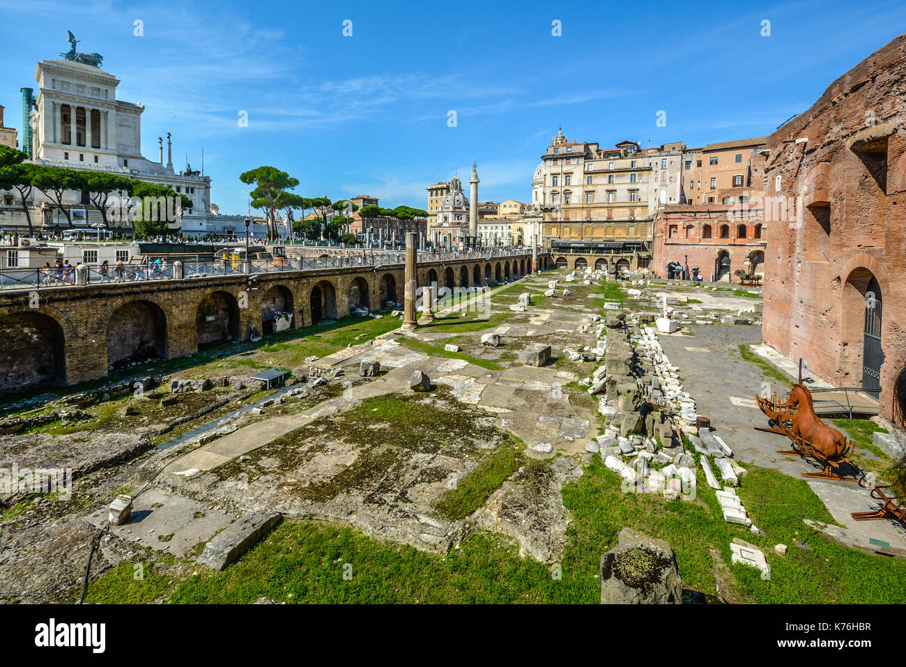 Ancient Roman ruins near the Vittorio Emanuele monument in Rome Italy on a sunny summer day - Stock Image