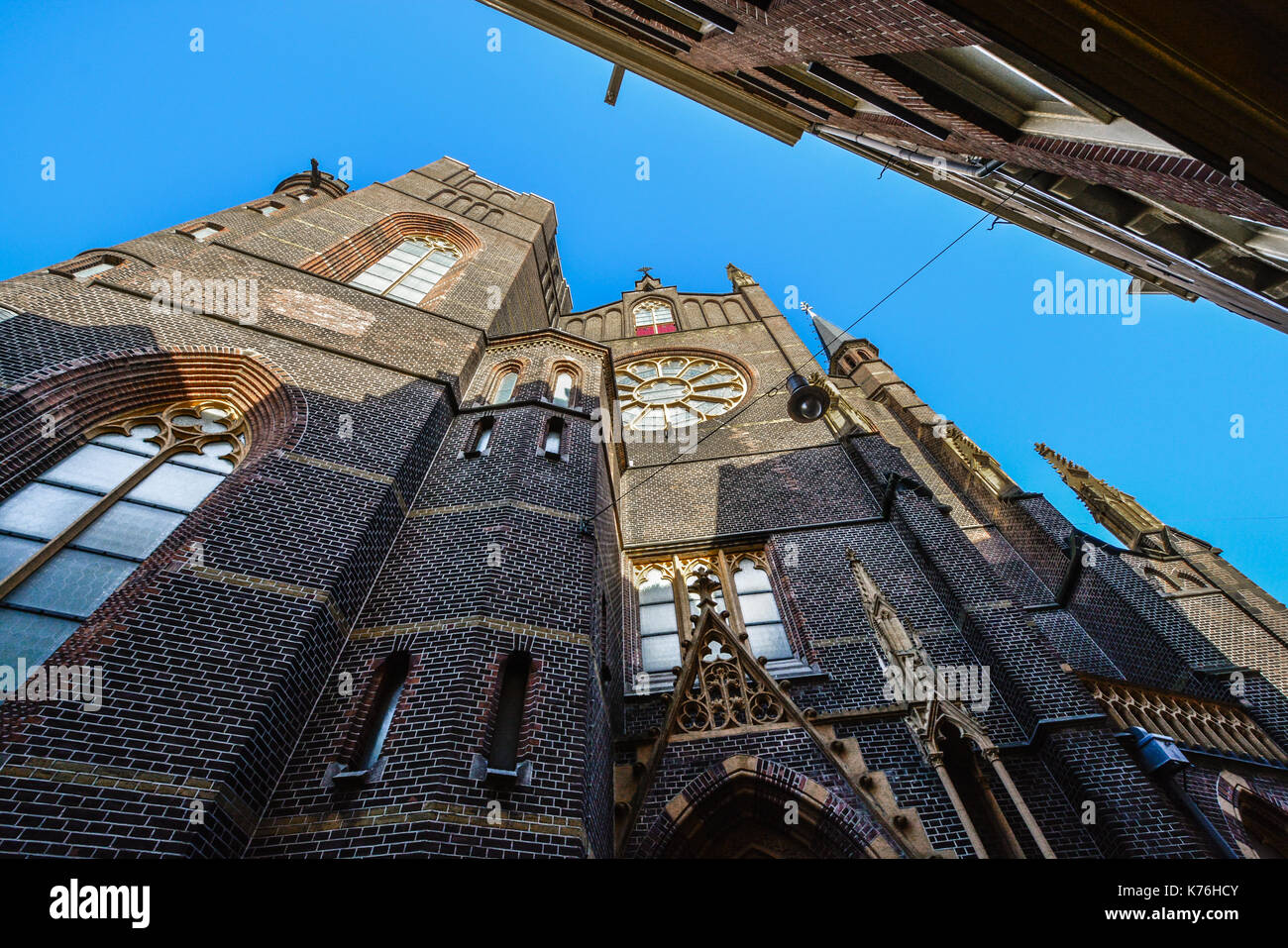 Brick, gothic church made of brick in the historic center of Amsterdam - Stock Image