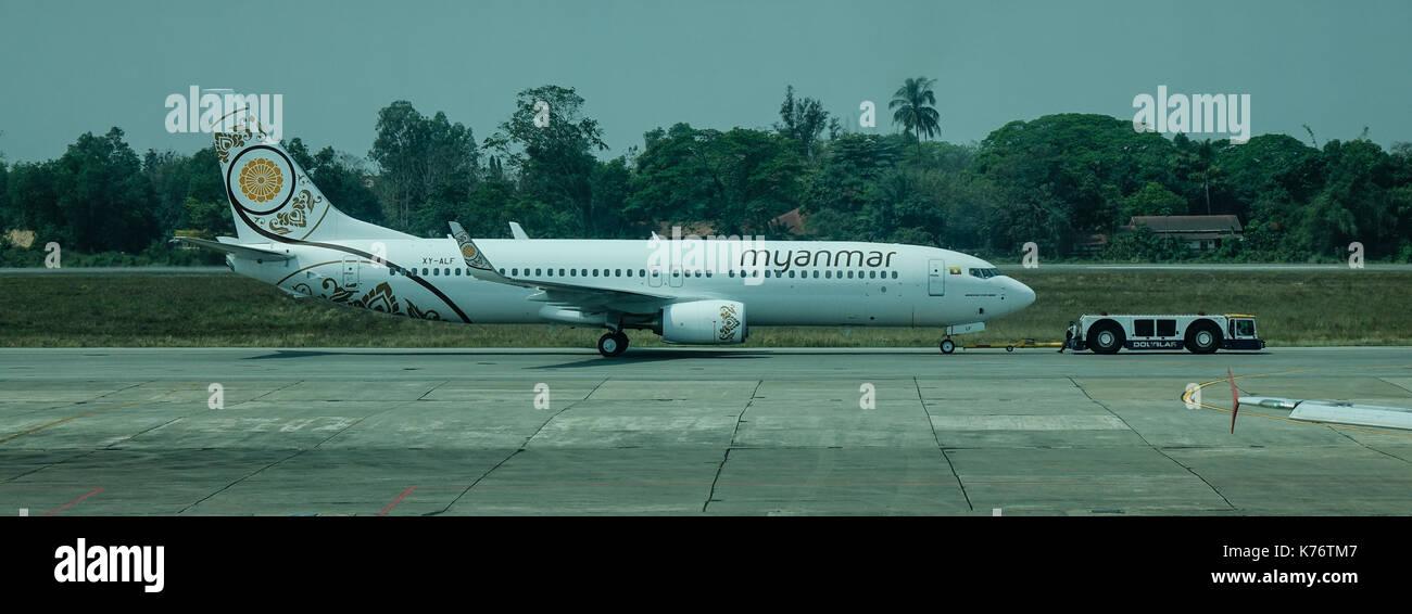 Yangon, Myanmar - Feb 27, 2016. A civil aircraft at airport in Yangon, Myanmar. Yangon Airport (Mingladon) is located approximately 30 minutes north o - Stock Image