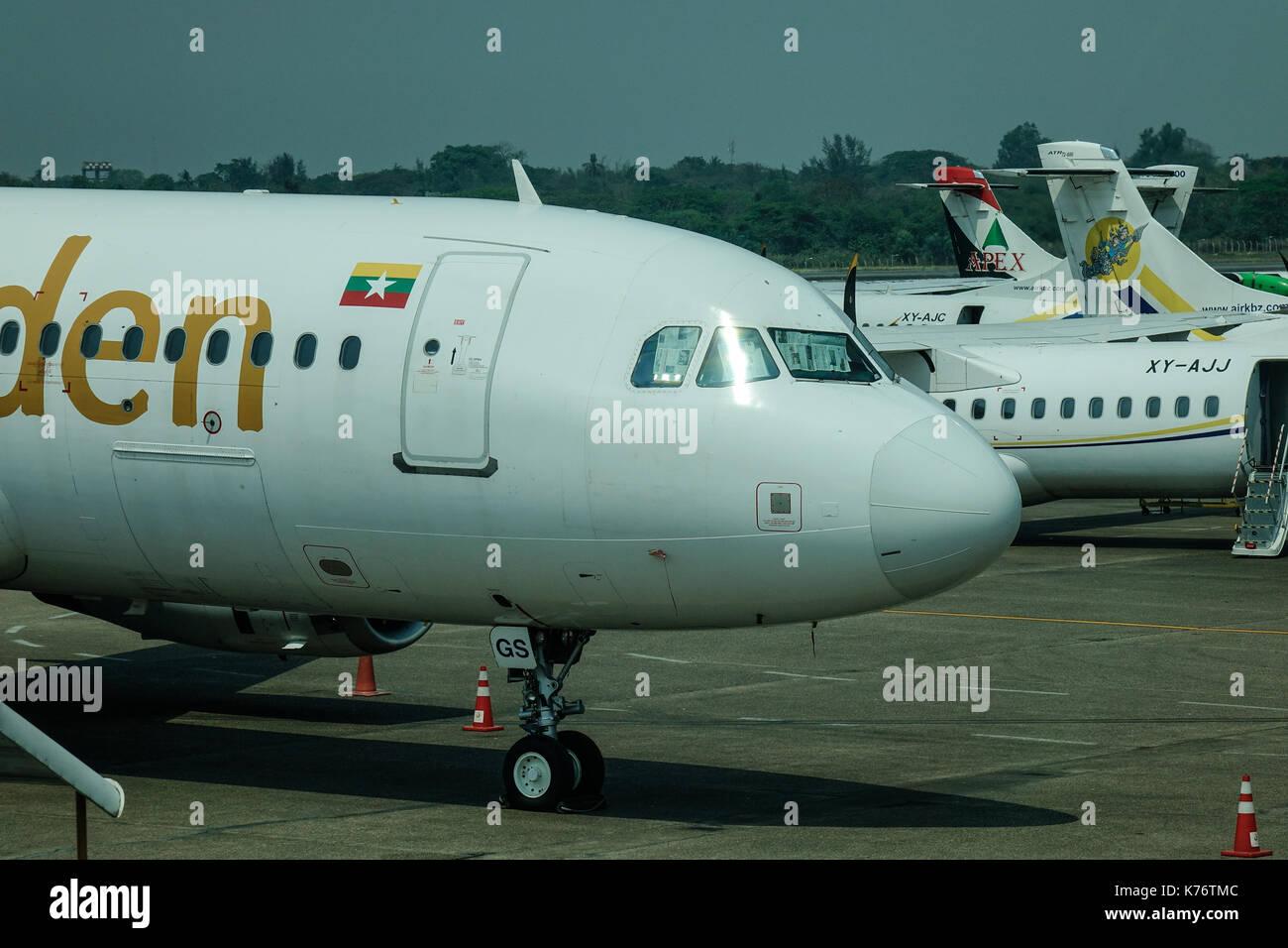 Yangon, Myanmar - Feb 27, 2016. Civil aircrafts docking at airport in Yangon, Myanmar. Yangon International Airport is the primary international airpo - Stock Image