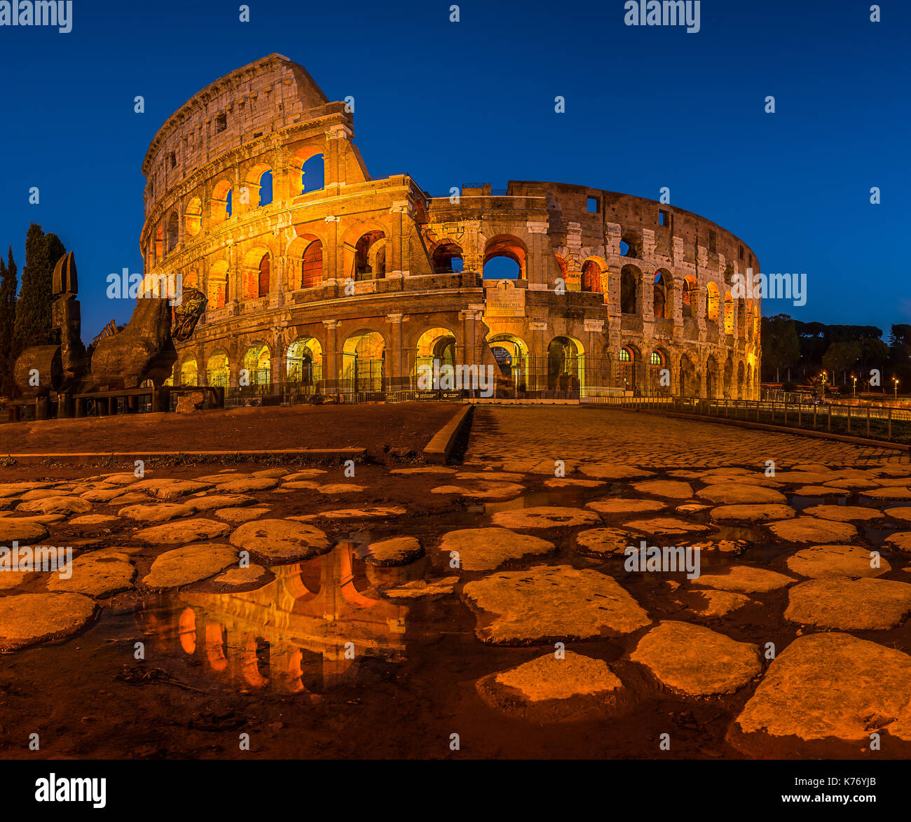 The perfect shot over the Colosseum. The foreground is reflecting the famous building making the shot epic. This photo is Rome in one image. - Stock Image