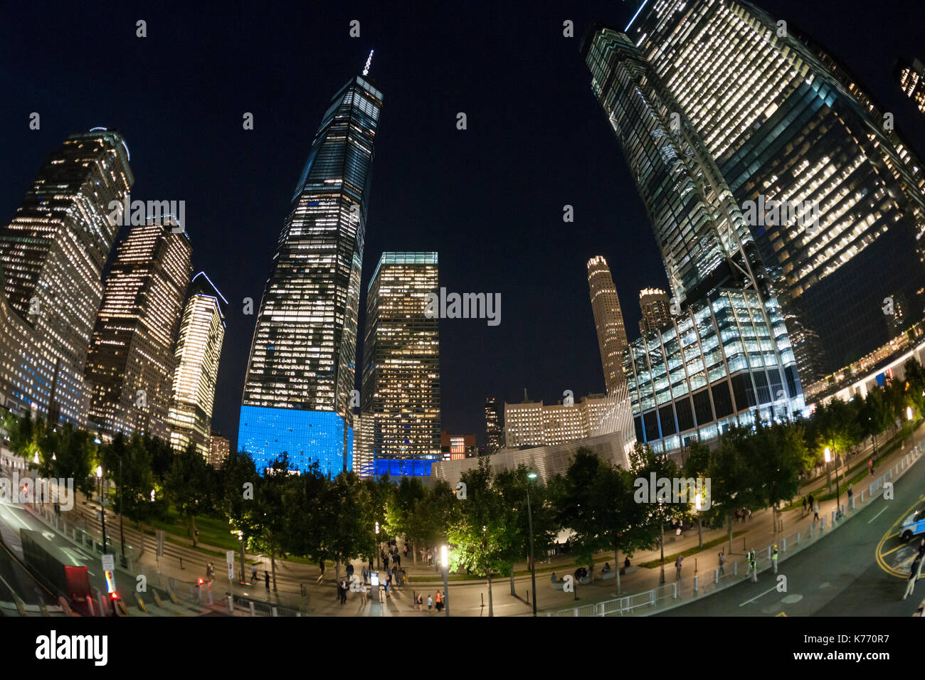 One World Trade Center lit up in blue with the 9/11 Memorial in New York on Monday, September 11, 2017 on the 16th anniversary of the September 11, 2001 terrorist attacks. (© Richard B. Levine) - Stock Image