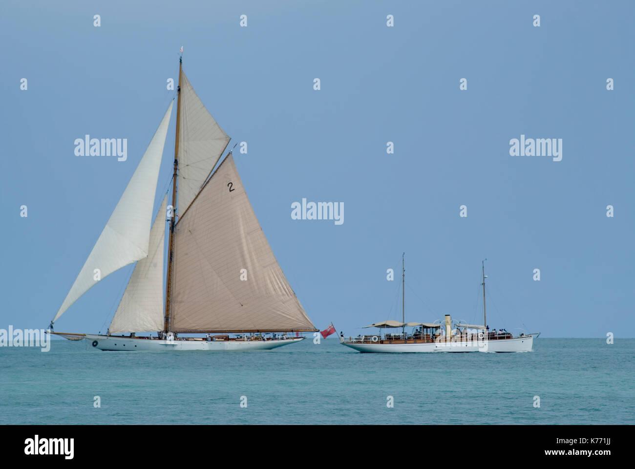 Ancient Riviera yachts cruising in mediterranean sea - Stock Image