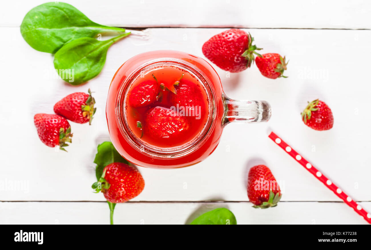 Strawberry smoothie or milkshake in a jar on white background, healthy food for breakfast and snack Stock Photo