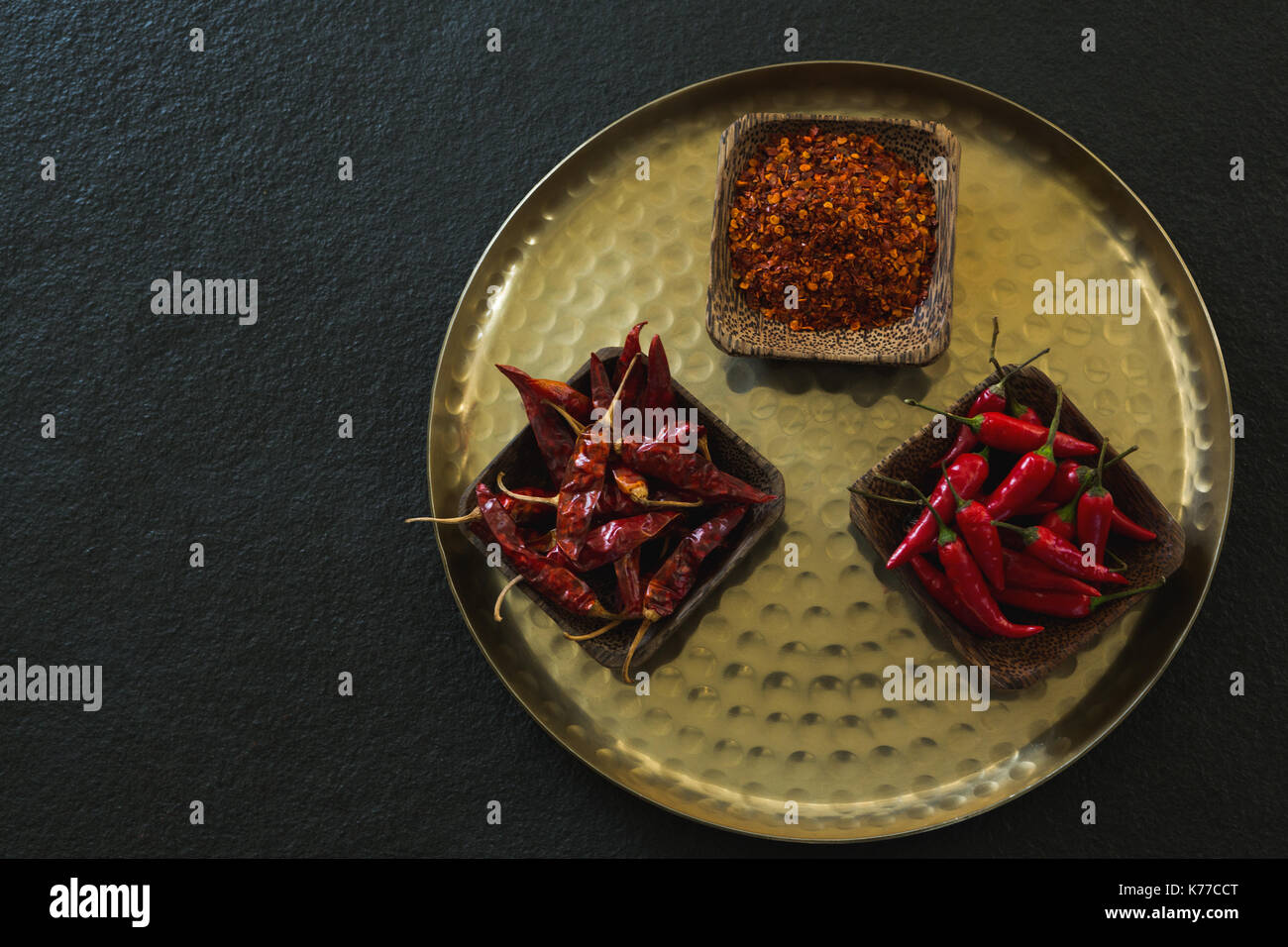 Overhead of red chilies, dried red chili pepper and crushed red pepper in plate Stock Photo