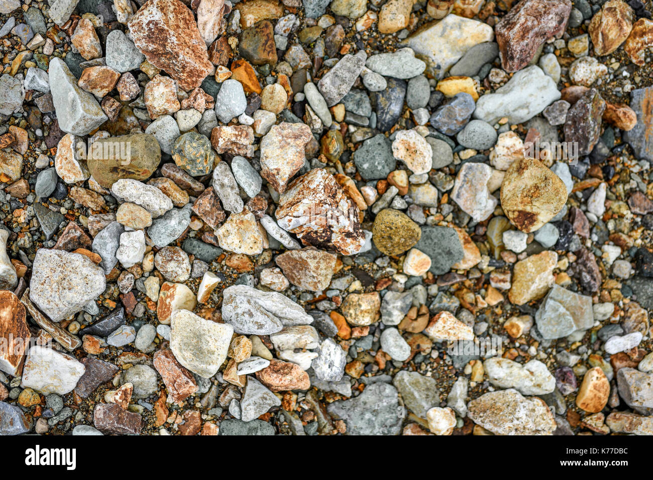 Texture of different sizes of colored stones, Iceland. - Stock Image