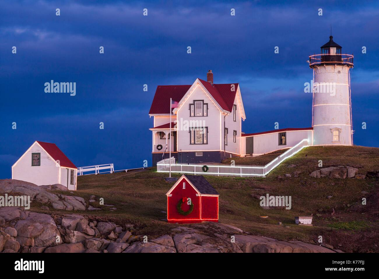 united states maine york beach nubble light lighthouse with christmas decorations dusk