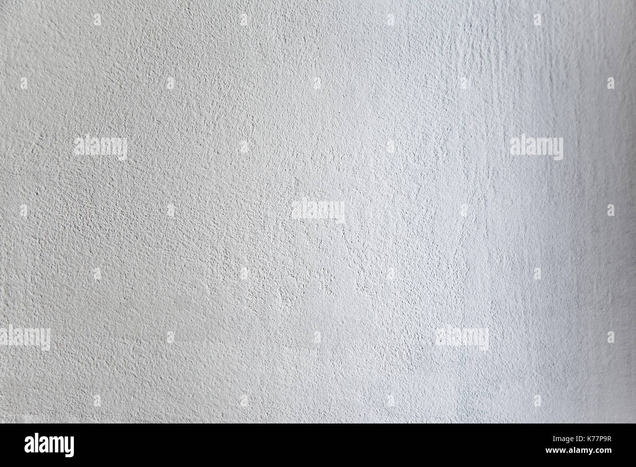Rough light white colored surface for backgrounds and textures. - Stock Image