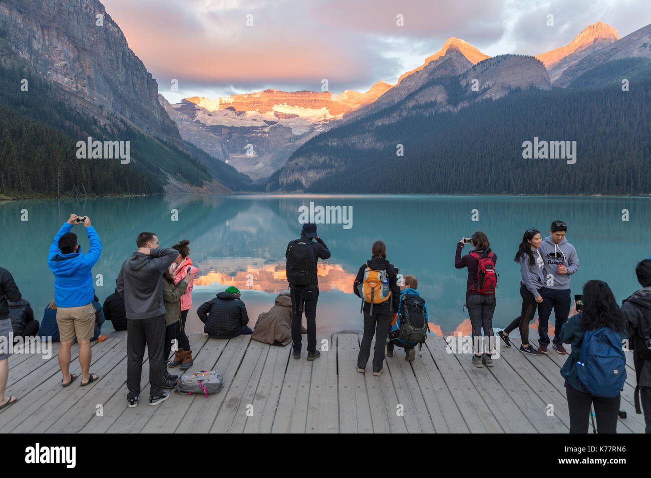 Banff National Park, Alberta Canada - 20 September 2017: Crowd of photographers and tourists at sunrise on the shore of Lake Louise - Stock Image