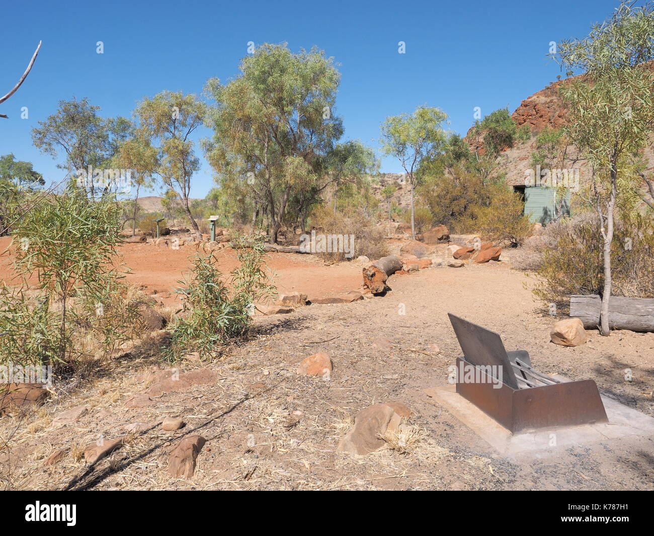 Camp ground with fire pit at remote N'Dhala Gorge near Ross River Station, east MacDonnell ranges , Alice Springs, Northern Territory, Australia 2017 - Stock Image