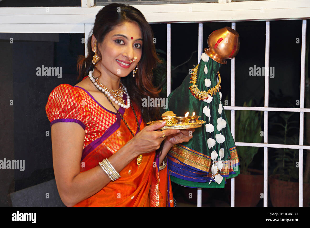 Indian woman standing doing puja on gudi padwa traditional new year for Marathi Hindus Stock Photo