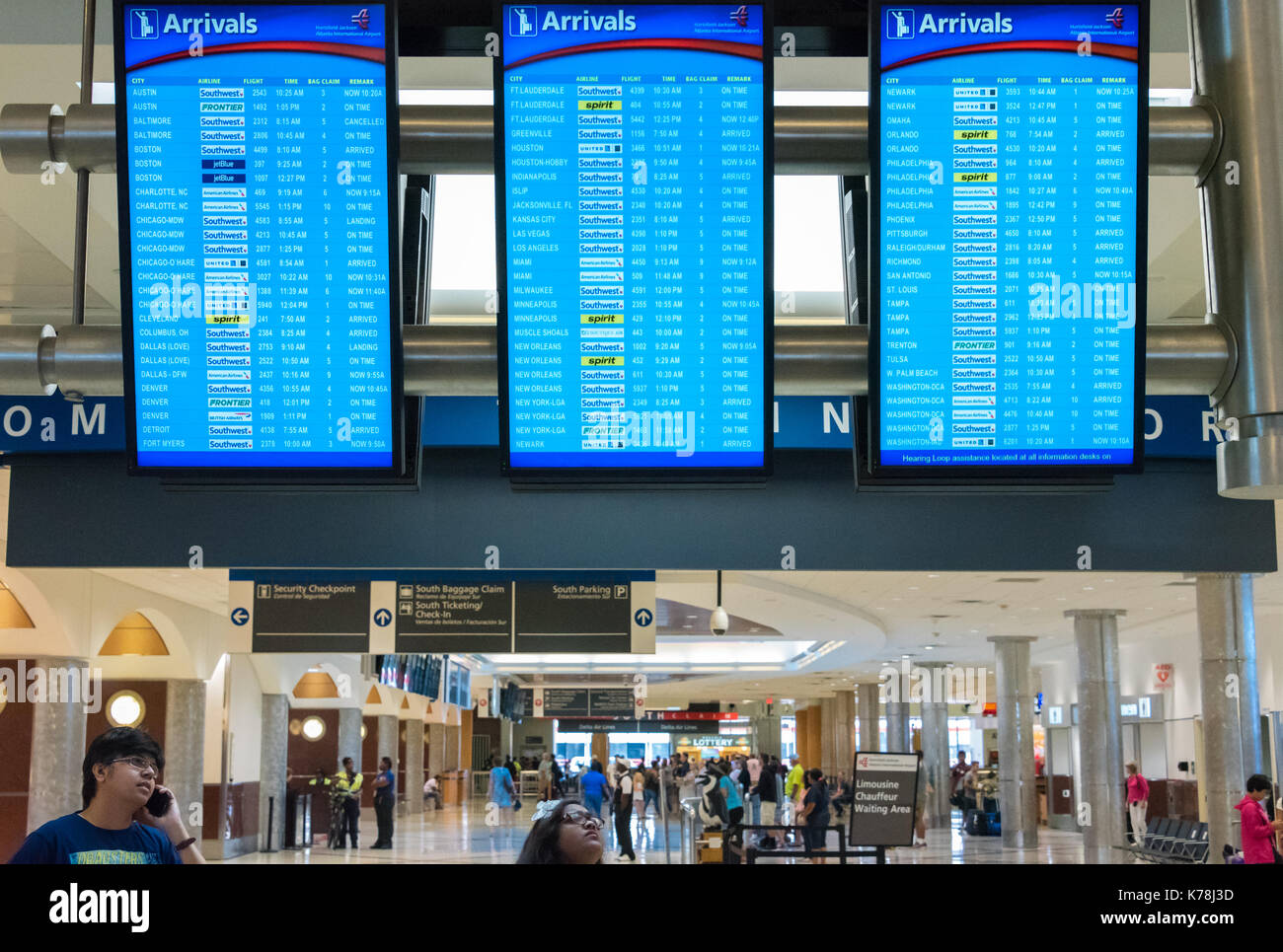 People checking flight arrival display boards at Hartsfield-Jackson Atlanta International Airport in Atlanta, Georgia. (USA) - Stock Image