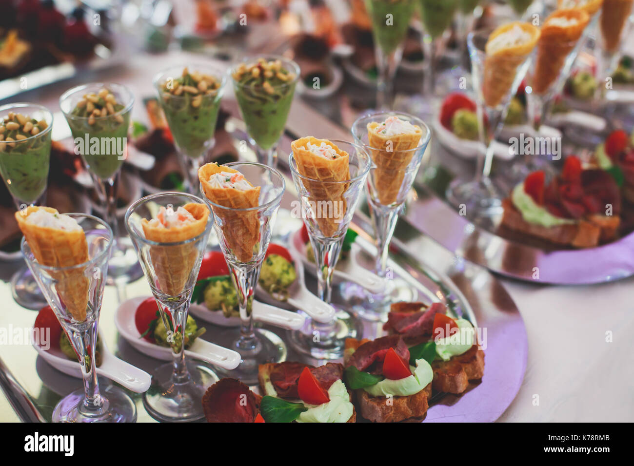 Beautifully decorated catering banquet table with different food snacks and appetizers on corporate christmas birthday Stock Photo