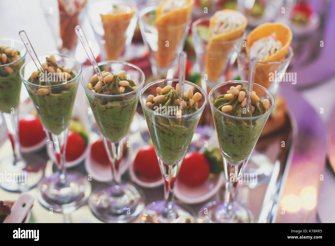 Beautifully decorated catering banquet table with different food snacks and appetizers on corporate christmas birthday party event or wedding celebrat - Stock Image