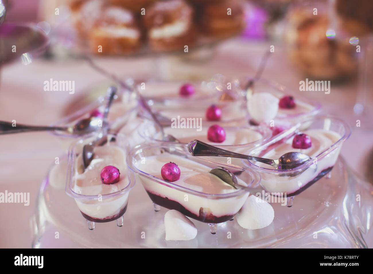 Beautiful multicolored decorated candy table baked sweet tasty cupcake cupcakes on a party with happy people around, beautifully decorated catering ba - Stock Image