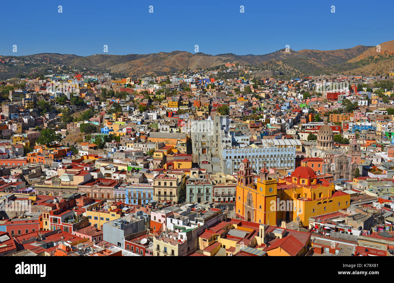 The colorful skyline of Guanajuato city during daytime with its beautiful Basilica of Our Lady with orange colours, Mexico. - Stock Image