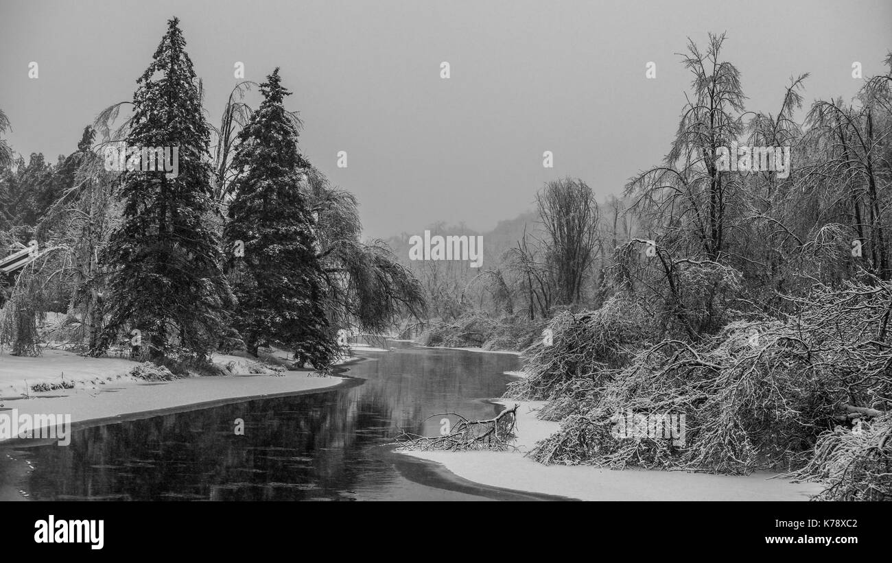 captured this river one afternoon during a gentle snowfall - Stock Image