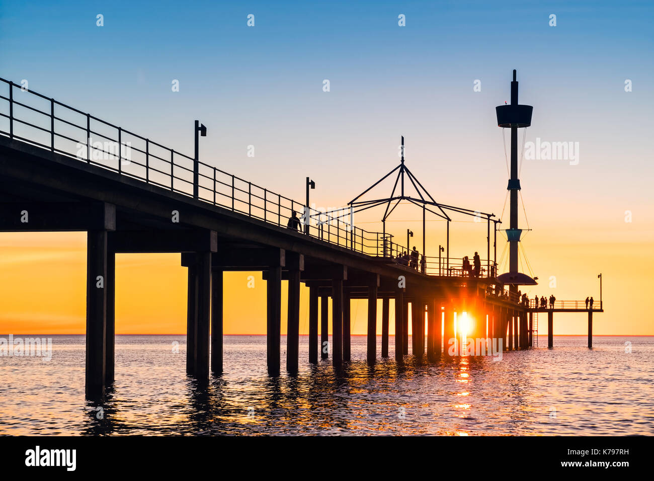 Brighton Beach pier with people at sunset, South Australia Stock Photo