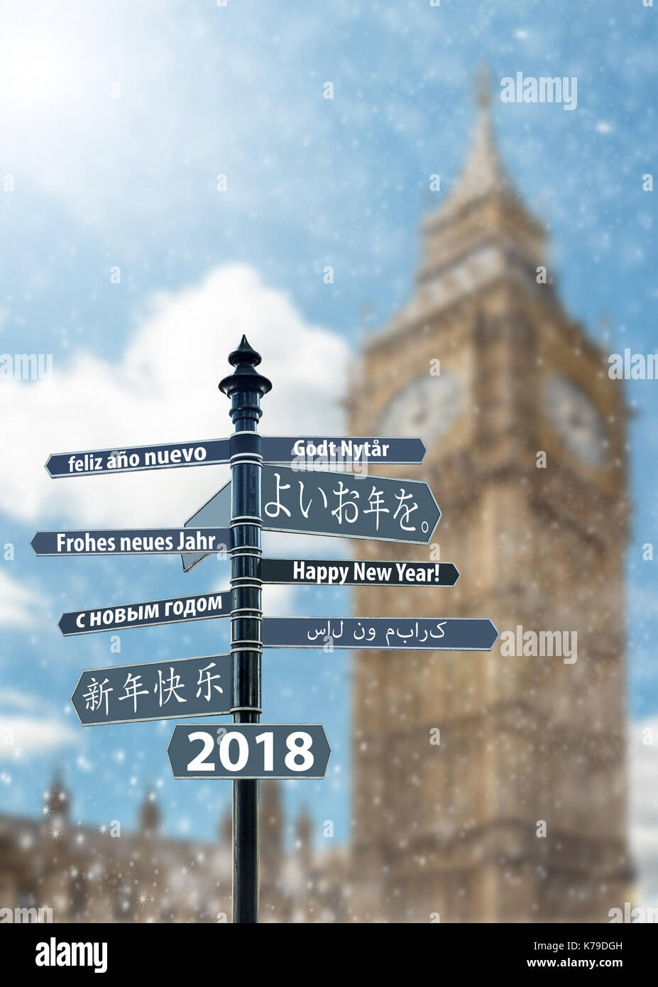 Signpost whit Happy New Year in many languages, Big Ben Clock Tower in background - Stock Image