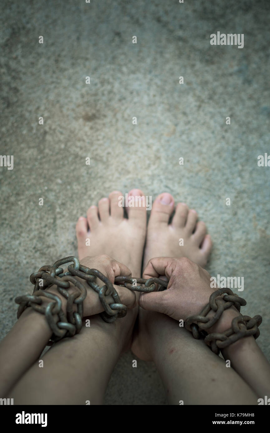 vintage tone of Shot focus of  hand of Woman  chained - Stock Image