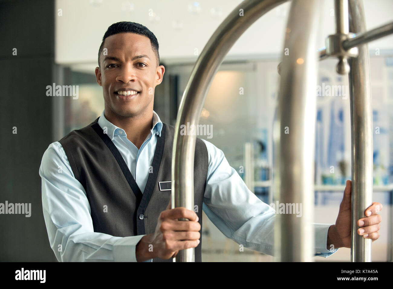 Bellhop at hotel - Stock Image