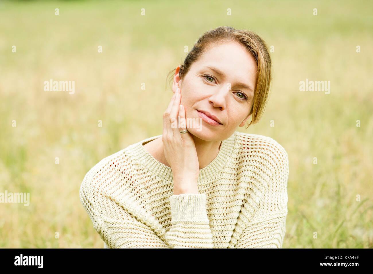 Woman contemplating, portrait - Stock Image