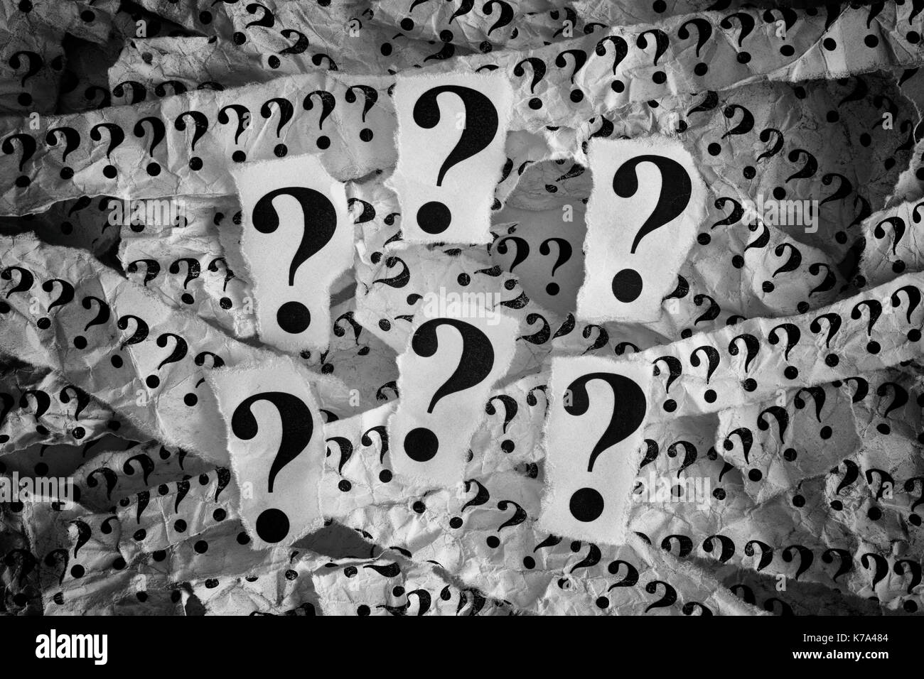 Question mark. Torn pieces of paper with question marks. Concept Image. Black and White. Closeup. - Stock Image