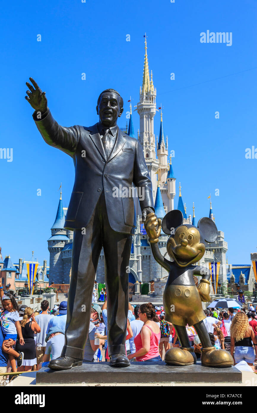 Iconic statue of Walt Disney holding hands with Mickey Mouse at The Magic Kingdom theme park, Orlando, Florida, Stock Photo