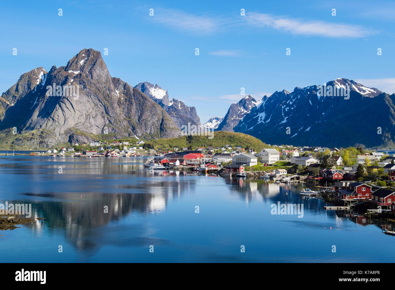 Reflections of mountains in scenic natural fishing harbour in summer. Reine, Moskenes, Moskenesøya Island, Lofoten Islands, Nordland, Norway - Stock Image