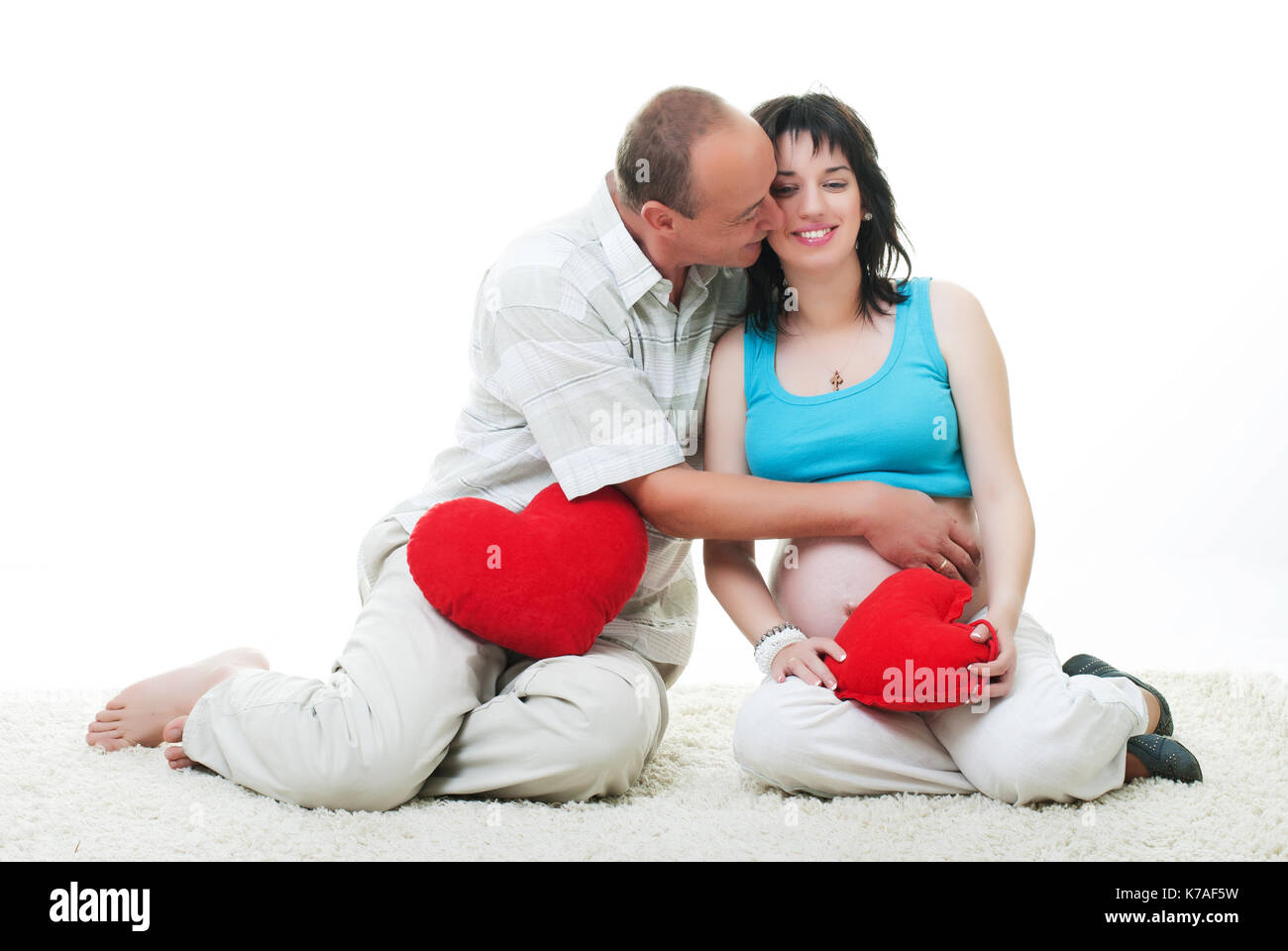 husband and pregnant women with heart - Stock Image