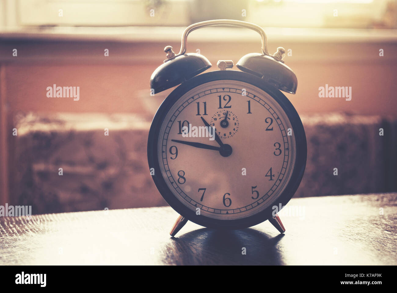old alarm clock with bells - Stock Image
