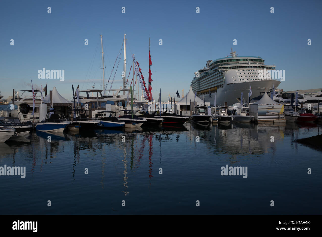 Southampton, UK. 15th Sep, 2017. Navigator of the seas docks beside The 49th Southampton Boat Show which gets underway today. It was officially opened by Fashion and Lifestyle Entrepreneur, Millie Mackintosh. The next ten days are sure to be one of the world's premier nautical events. There are attractions for all the family with boats of various shapes and sizes from a dinghy to a super luxury motor yacht. Docked by the marina is Kaskelot one of the last remaining wooden tall ships for people to explore onboard and learn about its history Credit: Keith Larby/Alamy Live News - Stock Image