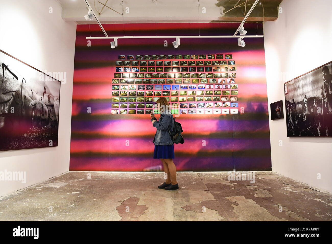 Yekaterinburg, Russia. 15th Sep, 2017. A visitor views showpieces on display at the 4th Ural Industrial Biennale: New Literacy exhibition of contemporary art in the building of the former Ural instrument-making plant. Credit: Donat Sorokin/TASS/Alamy Live News - Stock Image