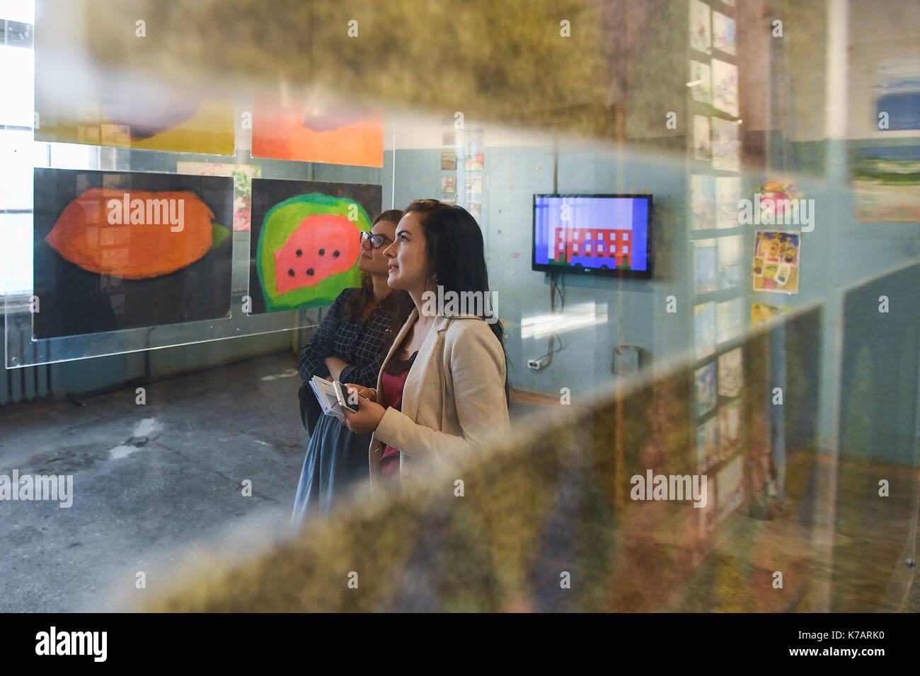 Yekaterinburg, Russia. 15th Sep, 2017. Visitors view showpieces on display at the 4th Ural Industrial Biennale: New Literacy exhibition of contemporary art in the building of the former Ural instrument-making plant. Credit: Donat Sorokin/TASS/Alamy Live News - Stock Image
