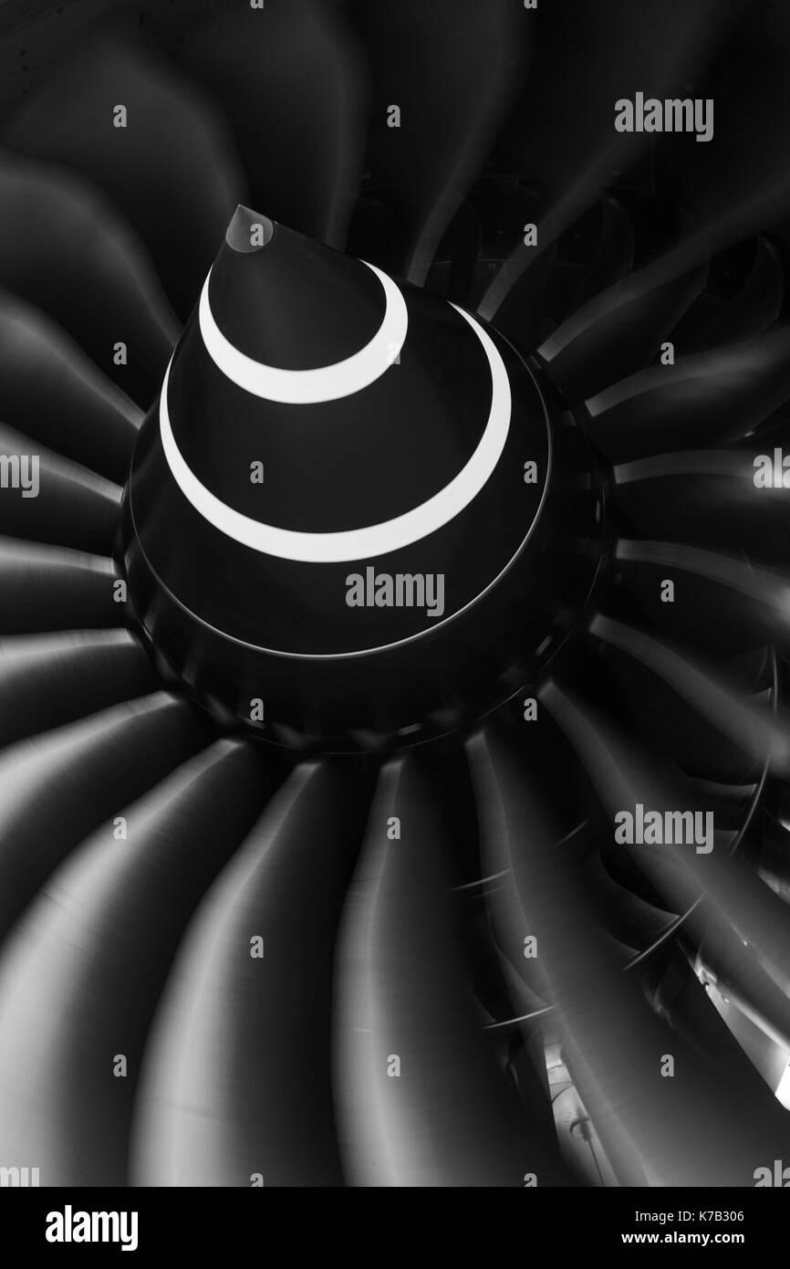 Monochrome image of a rotating Rolls Royce Trent turbofan engine. - Stock Image
