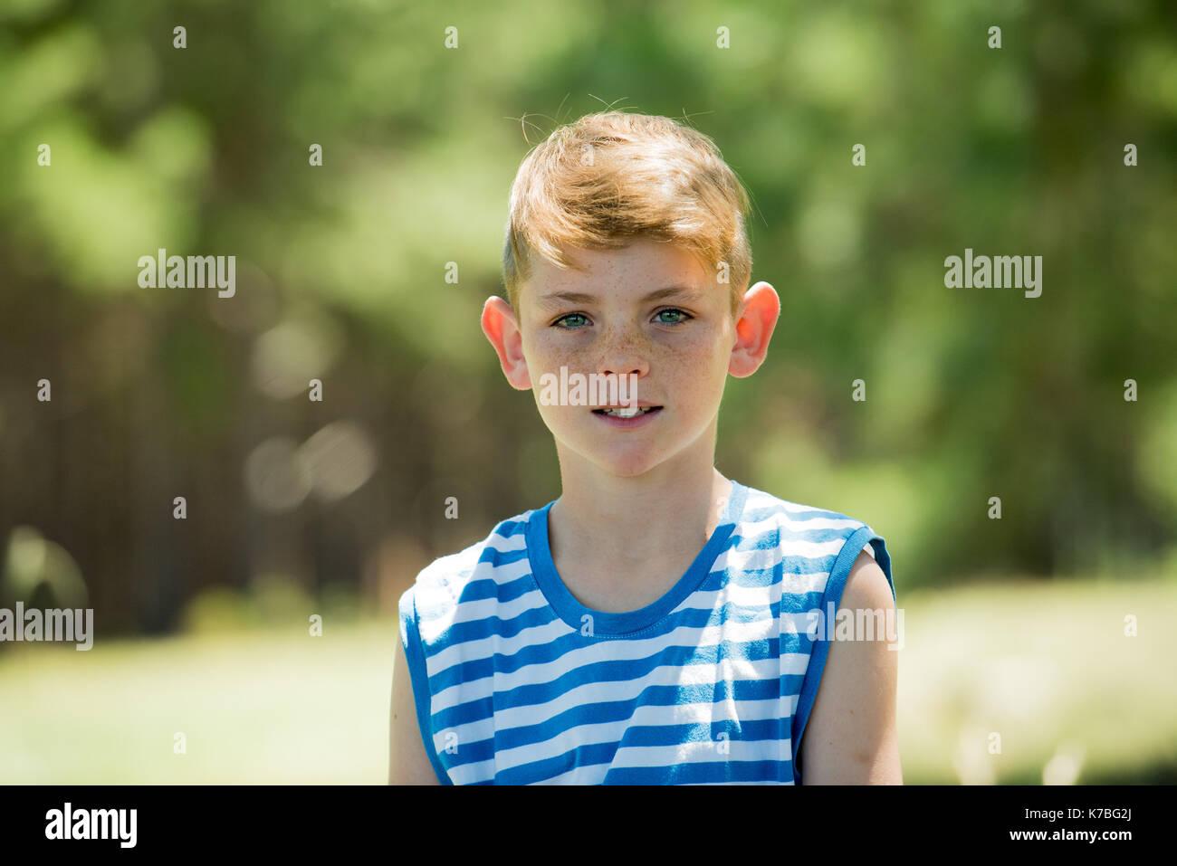 Boy outdoors, portrait - Stock Image