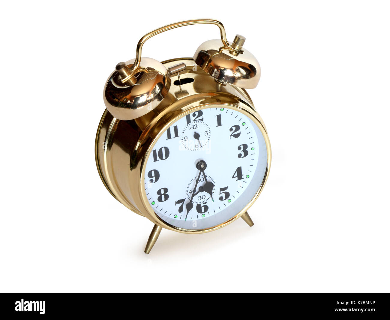 Nice gold alarm clock standing on white background. Clipping path is included - Stock Image