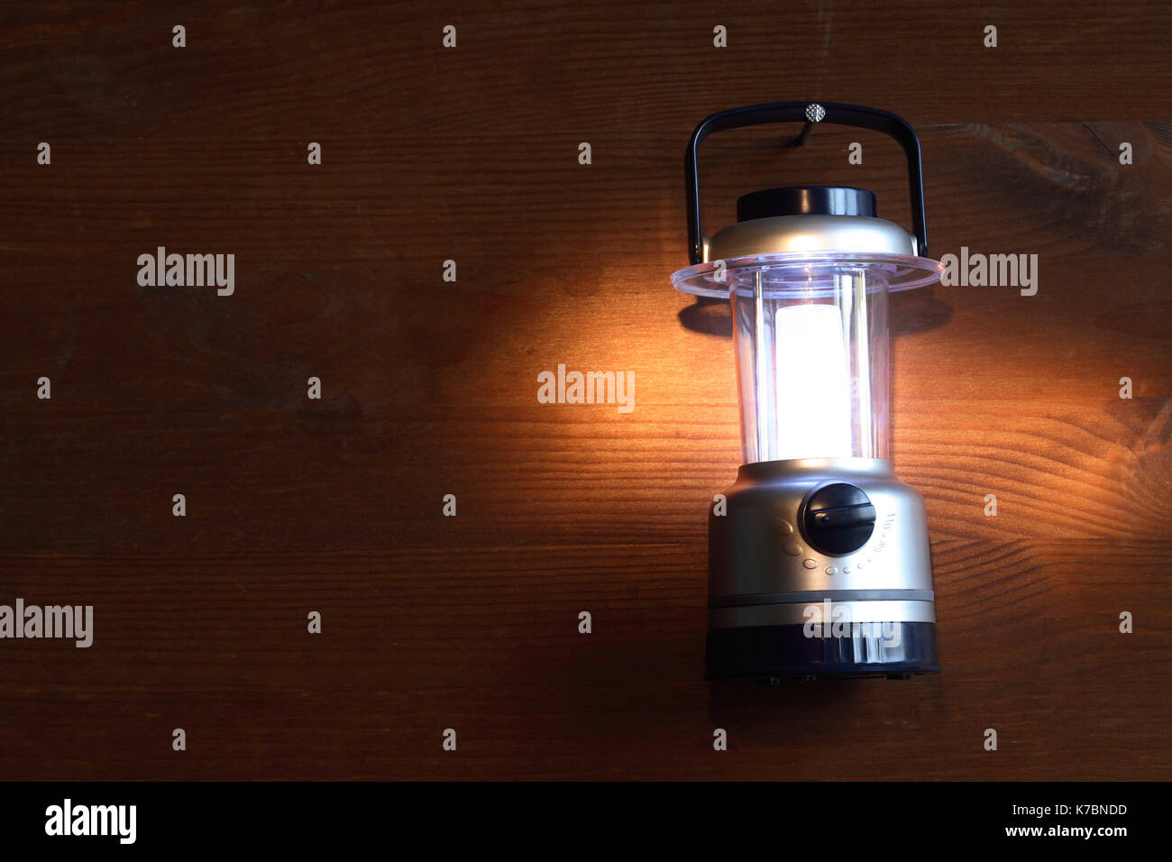 Modern Battery Powered Camping Lamp Hanging With Nail On Wooden Stock Photo Alamy