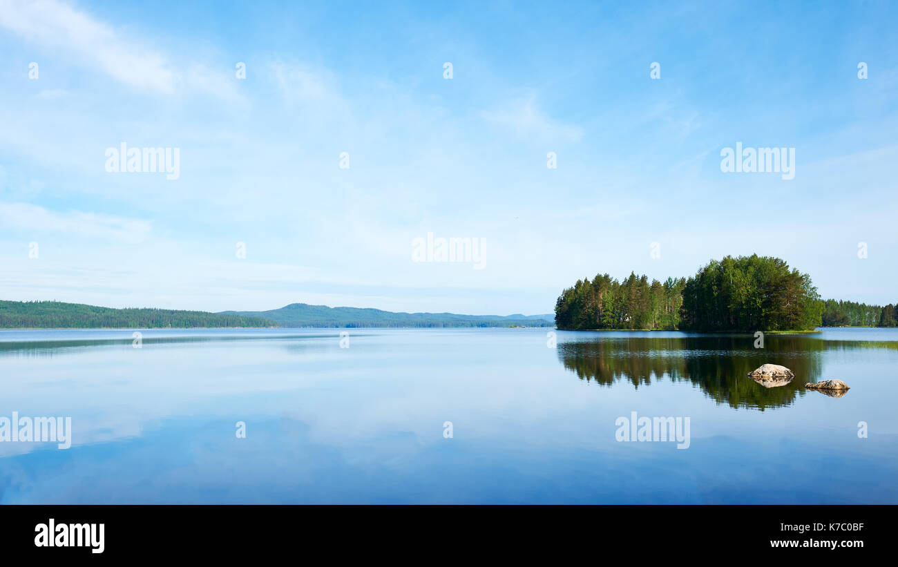 Beautiful Finnish Lake photographed in the bright Scandinavian summer - Stock Image