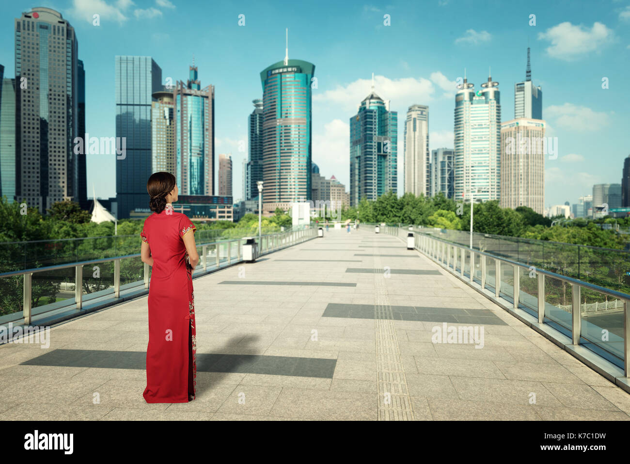 Asian young woman in Chinese traditional dress travel in Shanghai, China. - Stock Image