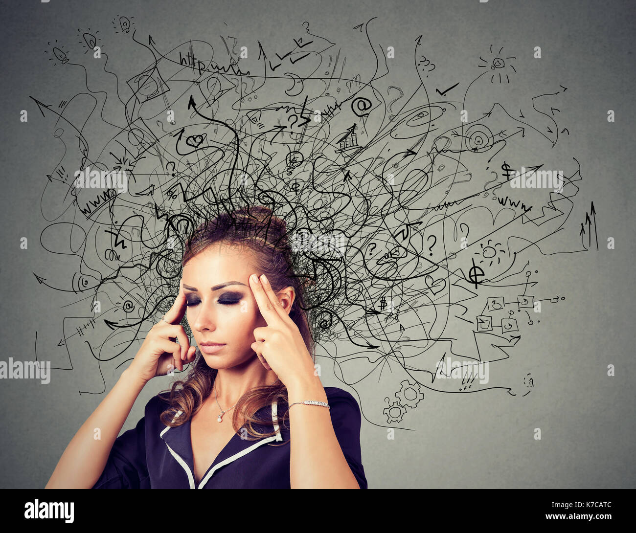 Thoughtful woman with a mess in her head - Stock Image