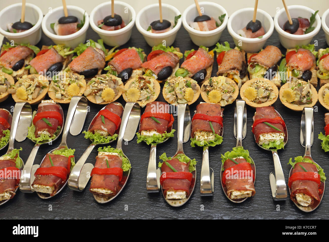 Modern Canapes Food Served in Bended Spoons - Stock Image