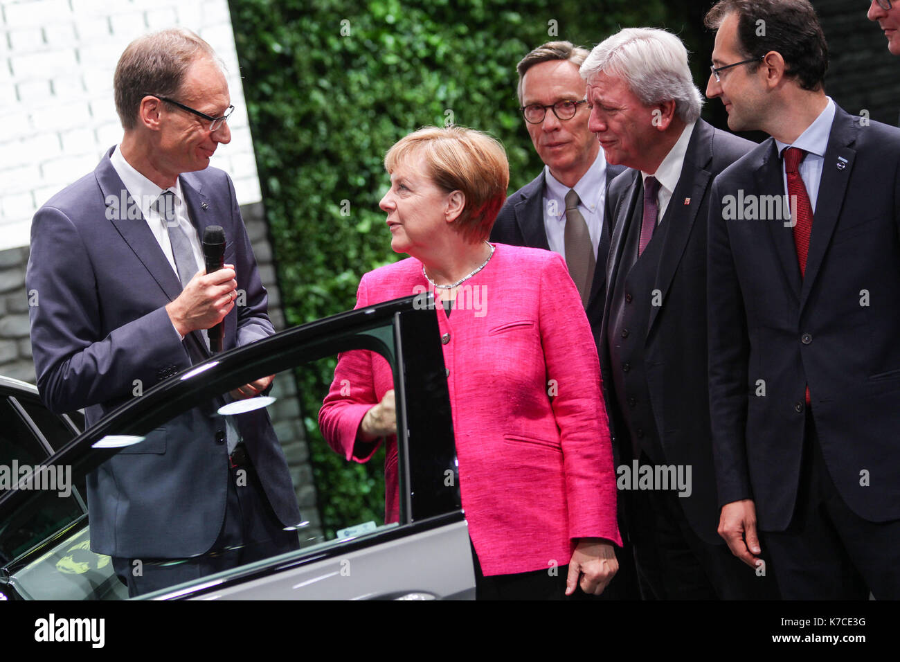 Frankfurt, Germany. 14th September, 2017. International Motor Show 2017 (IAA, Internationale Automobil-Ausstellung), opening walk with Angela Merkel, chancellor of Germany, here at Opel booth: Michael Lohscheller (CEO Opel), Angela Merkel, Matthias Wissmann (president of German Association of the Automotive Industry, VDA, Verband der Automobilindustrie), Volker Bouffier (prime minister of Hesse), Philippe de Rovira (Chief Financial Officer Opel). Credit: Christian Lademann - Stock Image