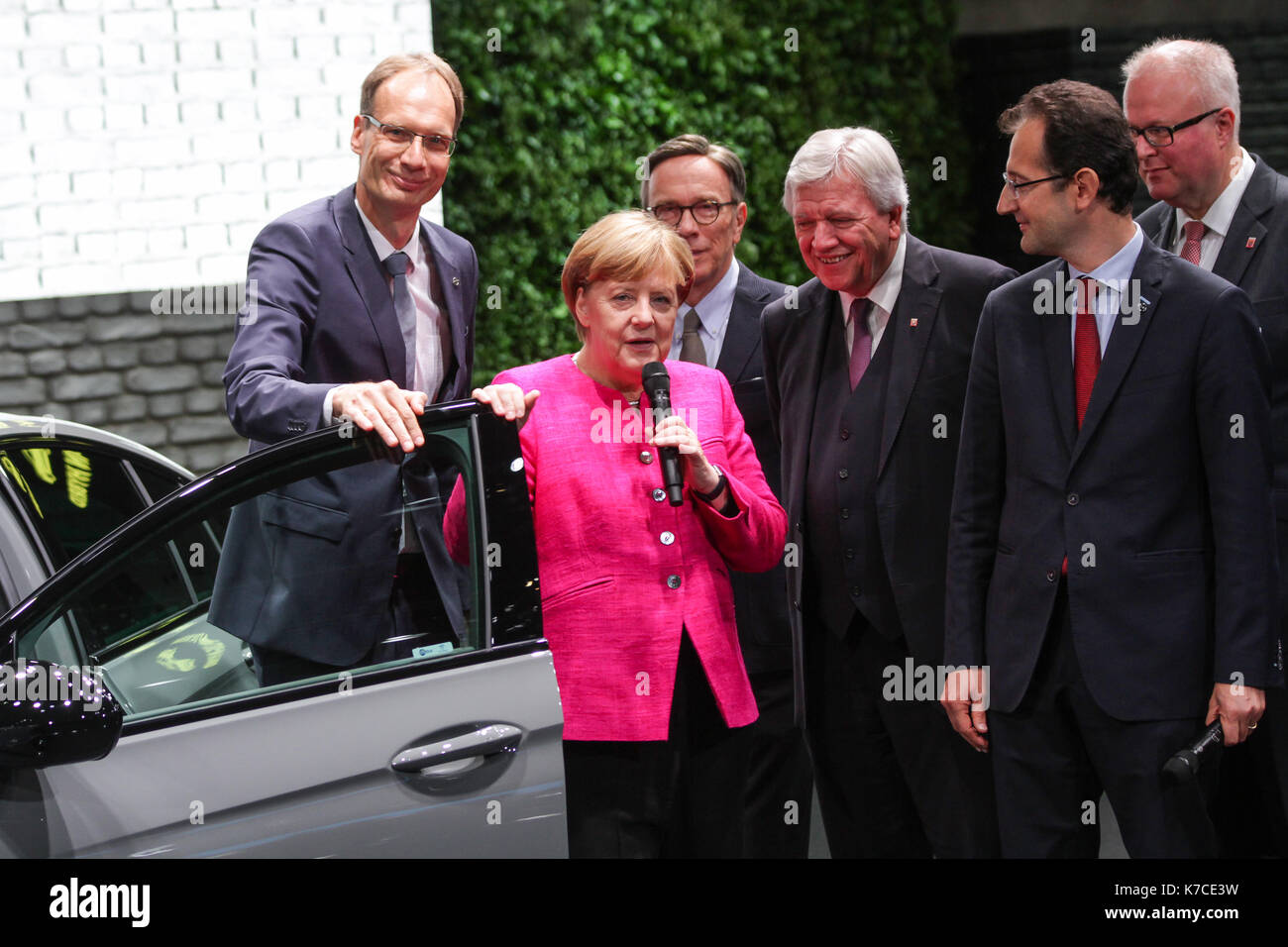 Frankfurt, Germany. 14th September, 2017. International Motor Show 2017 (IAA, Internationale Automobil-Ausstellung), opening walk with Angela Merkel, chancellor of Germany, here at Opel booth: Michael Lohscheller (CEO Opel), Angela Merkel, Matthias Wissmann (president of German Association of the Automotive Industry, VDA, Verband der Automobilindustrie), Volker Bouffier (prime minister of Hesse), Philippe de Rovira (Chief Financial Officer Opel), Thomas Schäfer (Minister of Finance of the state of Hesse). Credit: Christian Lademann - Stock Image